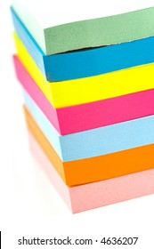 Stack of brightly colored sticky notes, slightly overexposed for effect