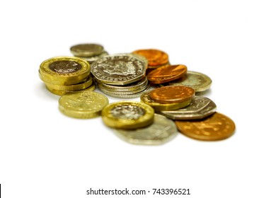 Stack of British currency coins isolate on white background.