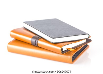 Stack brown and black leather diary books  isolated on white background.