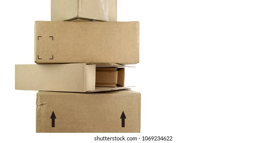 Stack of brown cardboard boxes. Isolated on white background. Room for text.