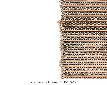 Stack of brown corrugated cardboard boxes isolated on white background with copy space. Edge view of flattened boxes. Nice for new packaging or recycling concept.