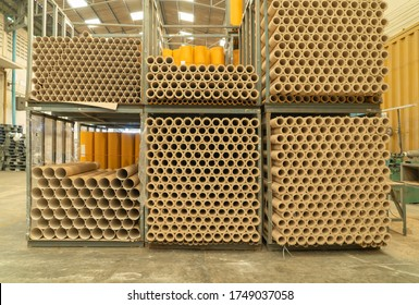Stack of a bunch of paper tube cores, tissues, in industry manufacturing plant factory. Raw product material of brown paper rolls. Cardboard cylinder cargo pattern in stock workshop storage warehouse.