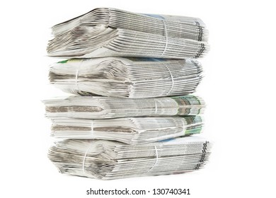 A stack of bundled freshly printed newspapers