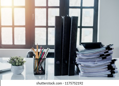 Stack of business paper on white desk, Pile of unfinished documents on office desk
