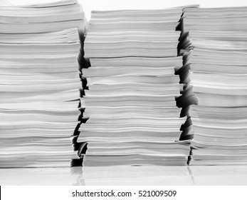 Stack of business papers on ceramic floor , white and black tone