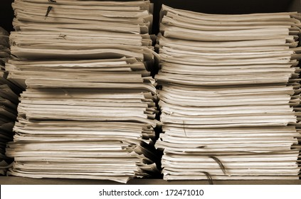 stack of business papers on the shelf