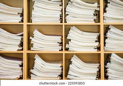 Stack of business papers on the wood shelf