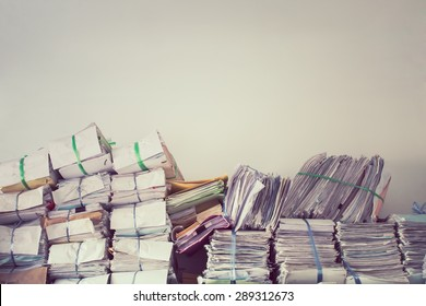 Stack of business report paper files on the document racks,in vintage style