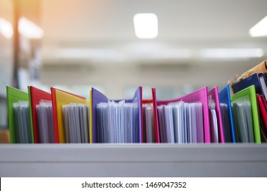 Stack or cabinet of document files in the office, business, finance, or education concept picture of pile of colorful files of papers in the business firm or company