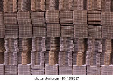 Stack of cardboard boxes. Corrugate cardboard. Corrugated paper single wall. Corrugated fiberboard. Linerboard board. Pleated paper.