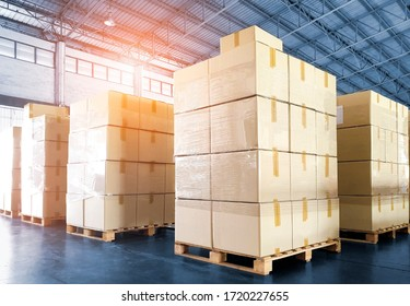stack of cardboard boxes on wooden pallets, interior of storage warehouse, package box, shipment export, warehouse logistics cargo shipping