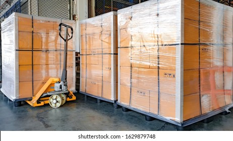 stack cardboard boxes wrapping plastic on pallets and hand pallet truck for export shipment, warehouse industry logistics, cargo transport