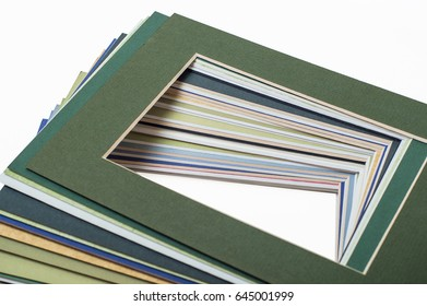 stack of cardboard picture frames on a white background, frame composition centered at an angle