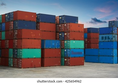 Stack of Cargo Containers at the docks , evening scene .