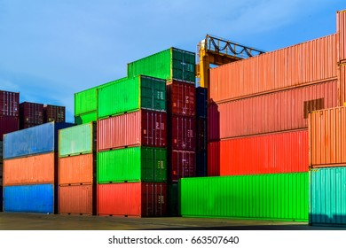 Stack of cargo containers at an industrial port. Port logistics, container yard operation, and handling.