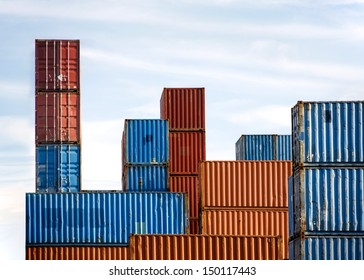 Stack of Cargo Containers in an inter-modal yard with blue sky