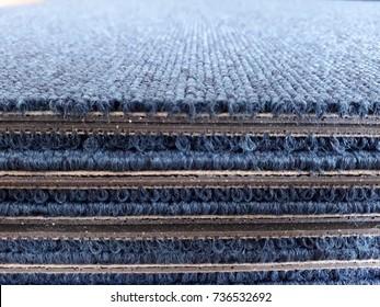 a stack of carpet tile