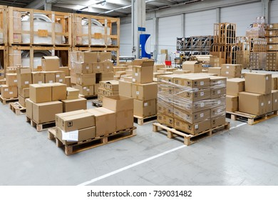 Stack of carton boxes at logistics warehouse