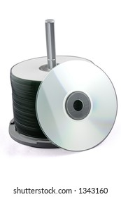 A stack of CDs on a spindle. Isolated on white with path.