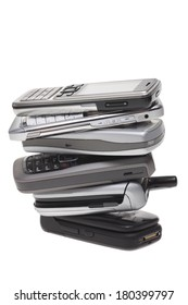 Stack of cell phones, cut out on white background