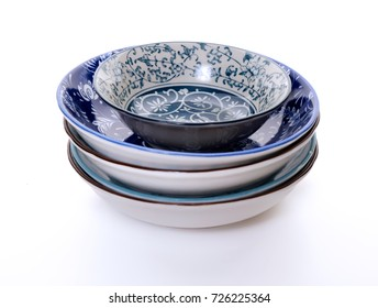 Stack of ceramic plates on white background