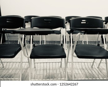 Stack of chairs in a class room unique photo