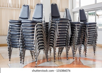Stack Of Chairs In Meeting Room