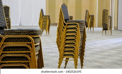 Stack of chairs in meeting room.