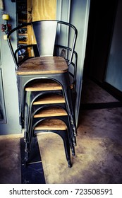 Stack chairs in the restaurant.