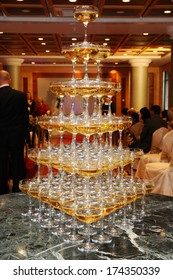 Stack of champagne glasses on table in wedding party