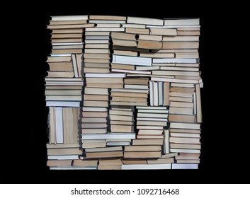 Stack of chaotically stacked books of different size and form. Isolated.