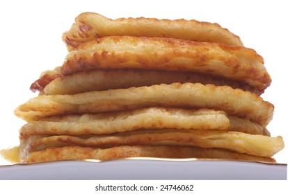 Stack of cheesy pancakes on the white background.