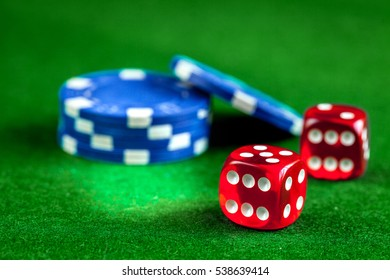 stack of chips play poker on green background close up