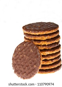 A stack of chocolate biscuits isolated against a white background