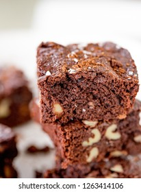 a stack of chocolate brownies on a white background