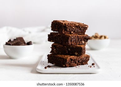 A stack of chocolate brownies on white background, homemade bakery and dessert. Bakery, confectionery concept