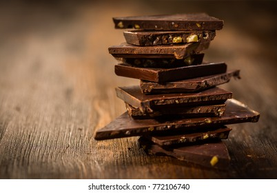 Stack chocolate on wooden table in vintage style