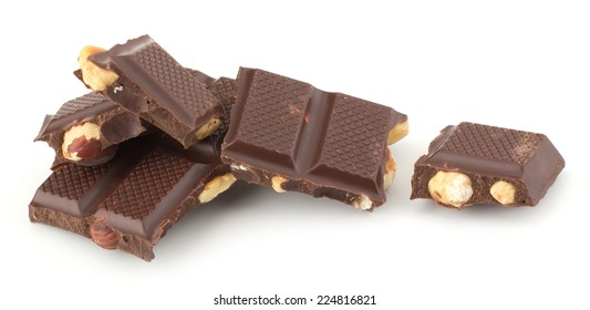Stack of chocolate pieces with nut isolated on white background