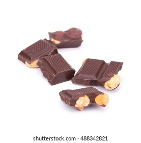 Stack of chocolate pieces with nuts isolated on white background