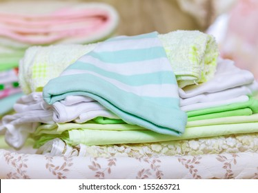 stack of clean baby clothes