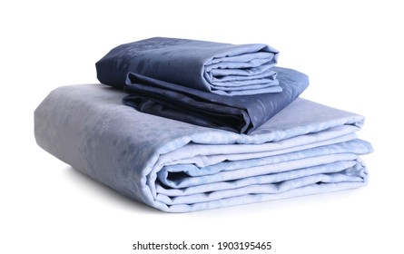 Stack of clean bed linen isolated on white