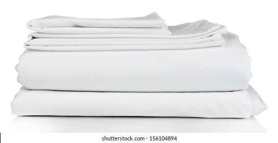 Stack of clean bedding sheets isolated on white