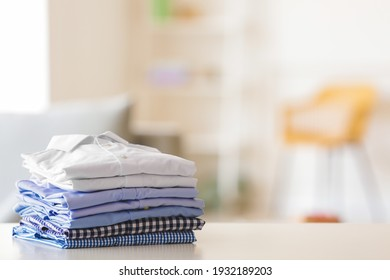 Stack of clean clothes on table in room