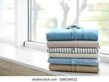 Stack of clean clothes on window sill