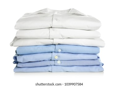 Stack of clean folded shirts on white background. Laundry day