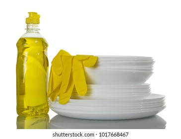 Stack of clean plates, means for dishwashing and gloves, isolated on white