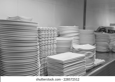 Stack of Cleaned Dishes in a Restaurant Room