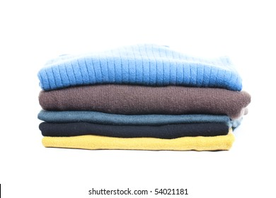 Stack of clothes on white background