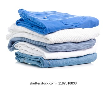Stack of clothing jeans sweaters on a white background isolation