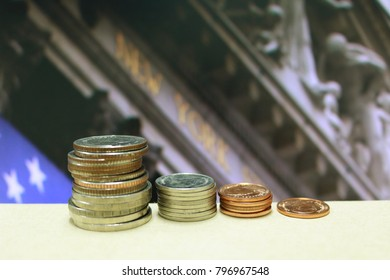 stack of coin, The background is New York Stock Exchange.